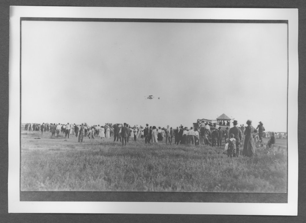 Scenes of Sherman County, Kansas - Curtiss biplane in flight.