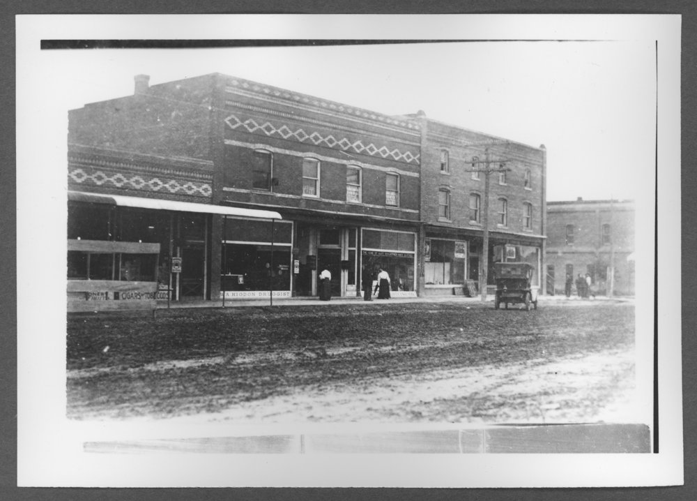 Scenes of Sherman County, Kansas - Street scene at the northwest corner of 10th and Main.