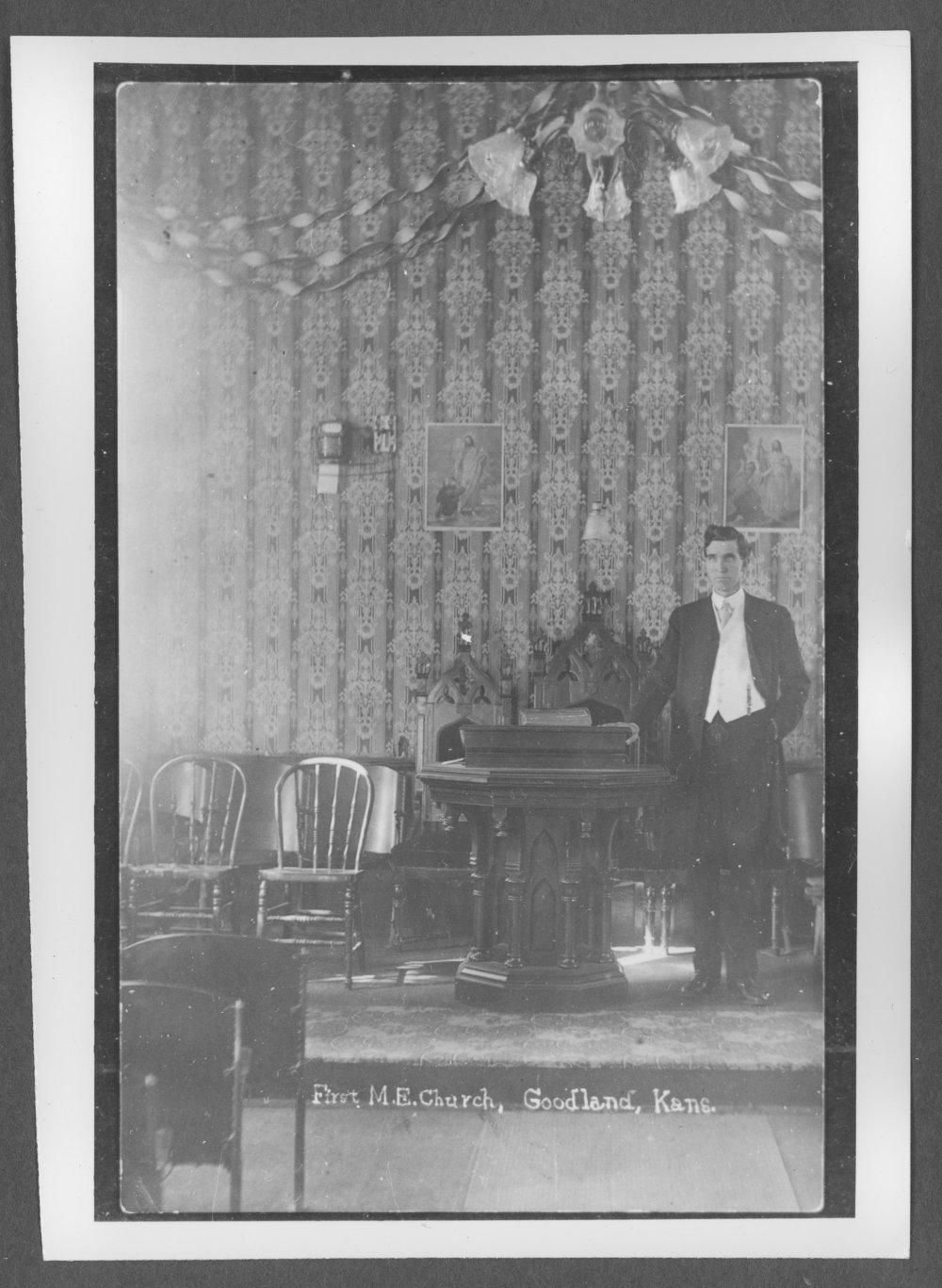 Scenes of Sherman County, Kansas - An unidentified man inside the Methodist Episcopal Church.