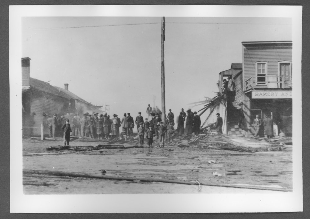Scenes of Sherman County, Kansas - Fire west side of Main between 10th and 11th, March 13, 1908.  Bock Hardware on the left and Roth Bakery on the right.