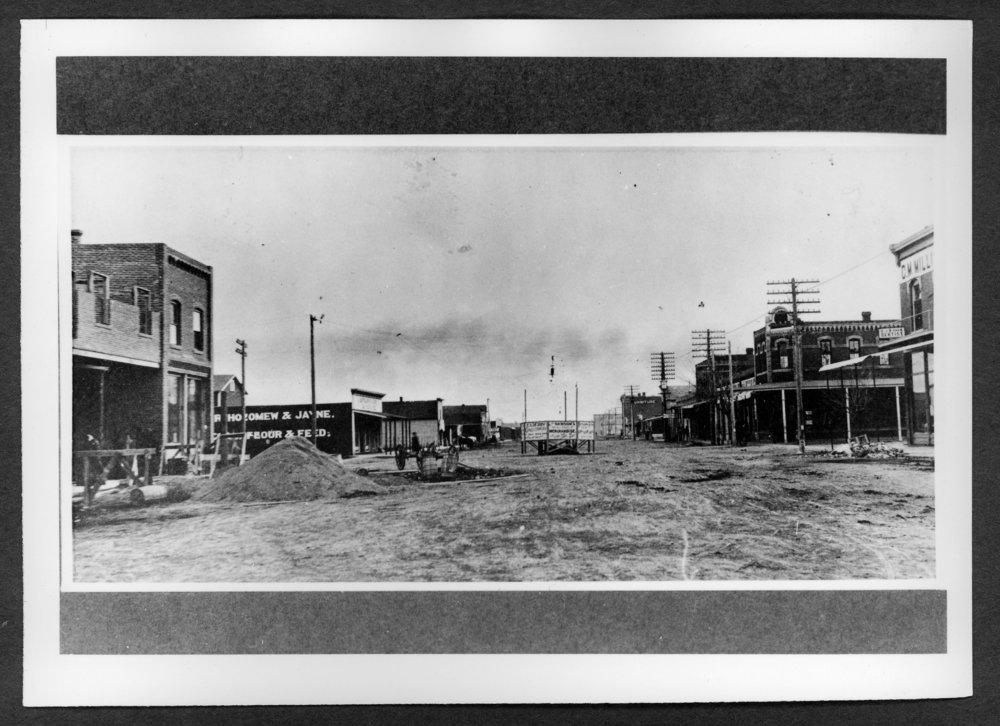 Scenes of Sherman County, Kansas - Looking south at 11th and Main.  Gray Front Hotel being built, Goodland, Kansas.