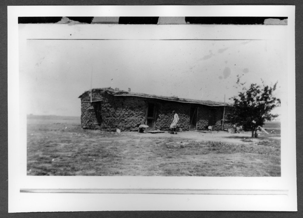 Scenes of Sherman County, Kansas - Nina Bardwell in front of the Bardwell sod house.