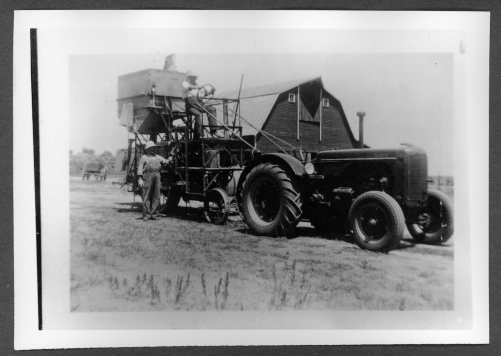 Scenes of Sherman County, Kansas - George Spomer farm with George operating the equipment.