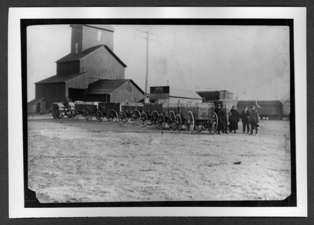 Scenes of Sherman County, Kansas - Wagon loads of wheat being pulled to the elevator, Goodland, Kansas, January 12, 1917.