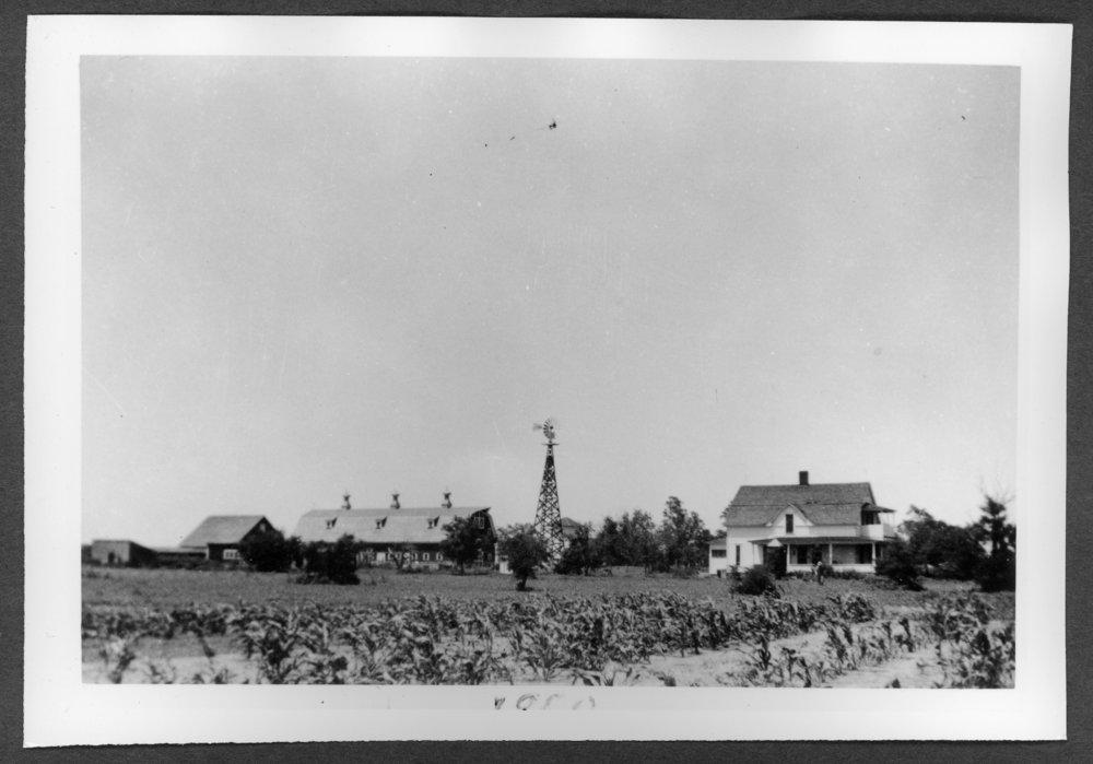 Scenes of Sherman County, Kansas - John L. Veselik home and barn, 1950.