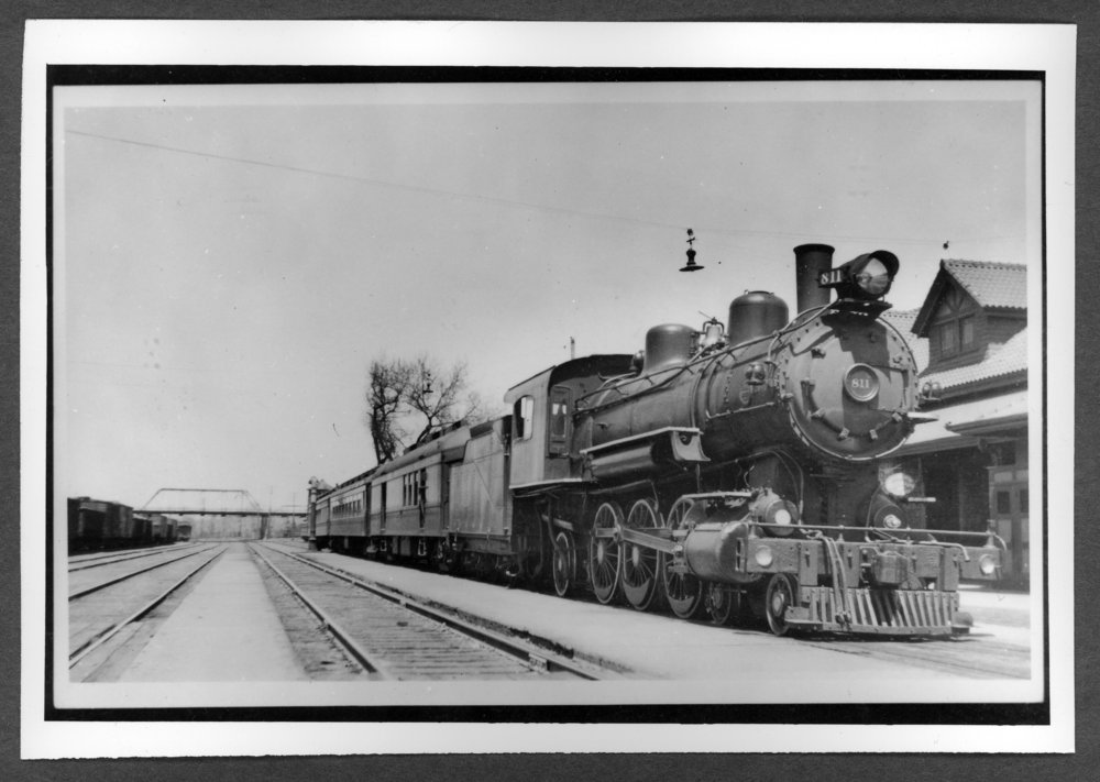 Scenes of Sherman County, Kansas - Engine 811 with passenger train at the depot in Colorado Springs, Colorado.