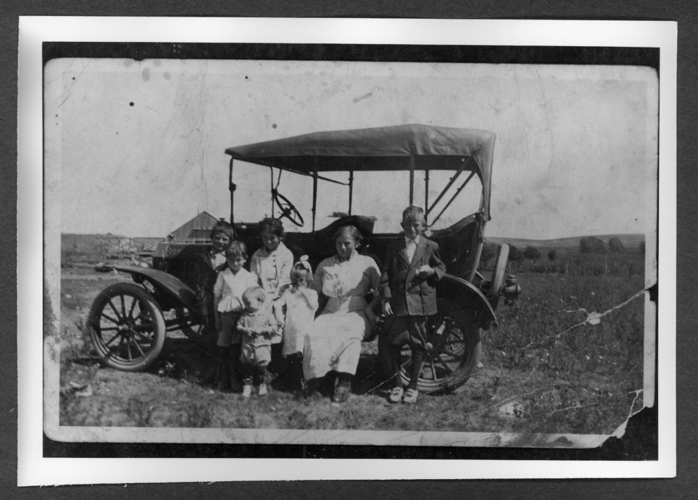 Scenes of Sherman County, Kansas - The Hartley family and their 1917 Model T Ford.  Pictured left to right: Robert, Susie, Verne, George, Pike, Leota, and Willard.