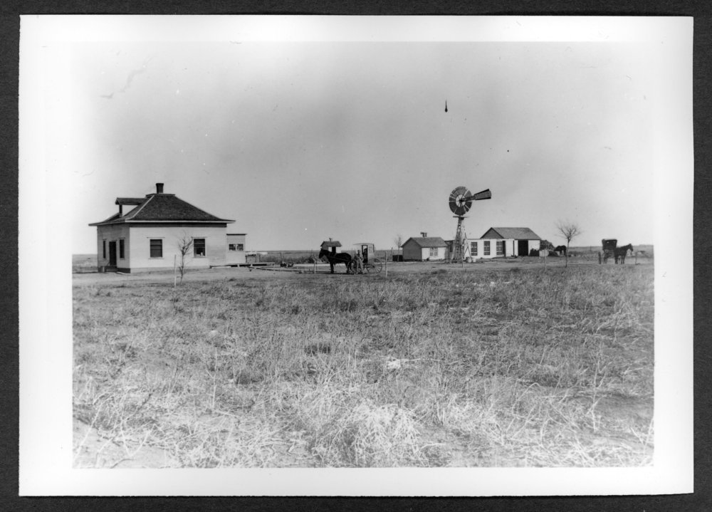 Scenes of Sherman County, Kansas - Fred Kohler farm, 3/4 mile southwest of Goodland, with a rural mail delivery cart in the yard.