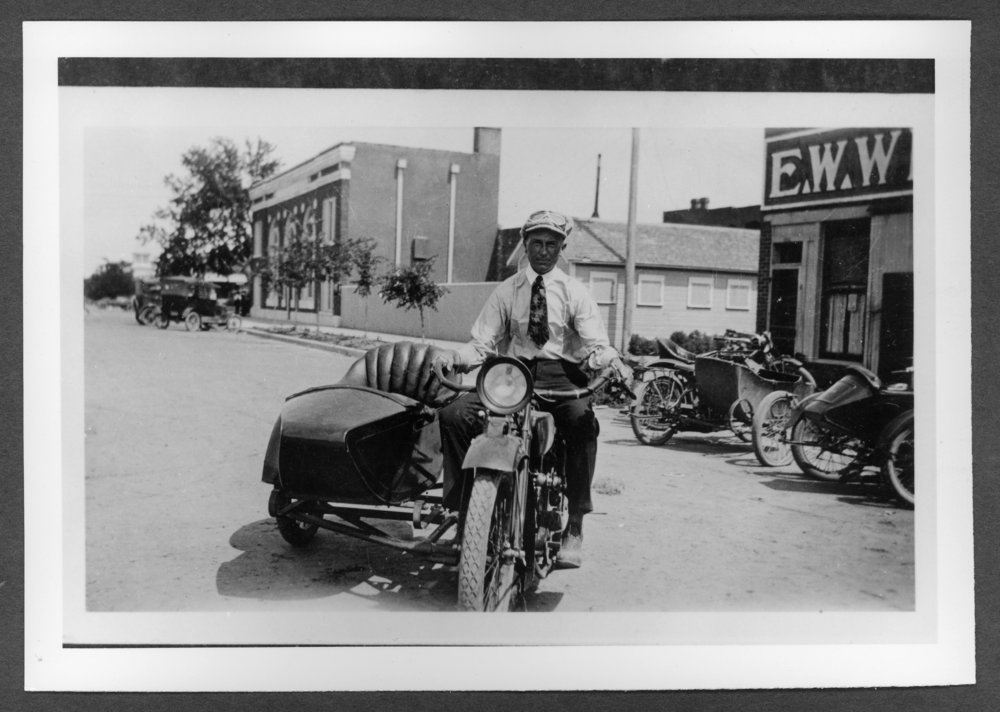 Scenes of Sherman County, Kansas - August Rohr on a motorcycle.