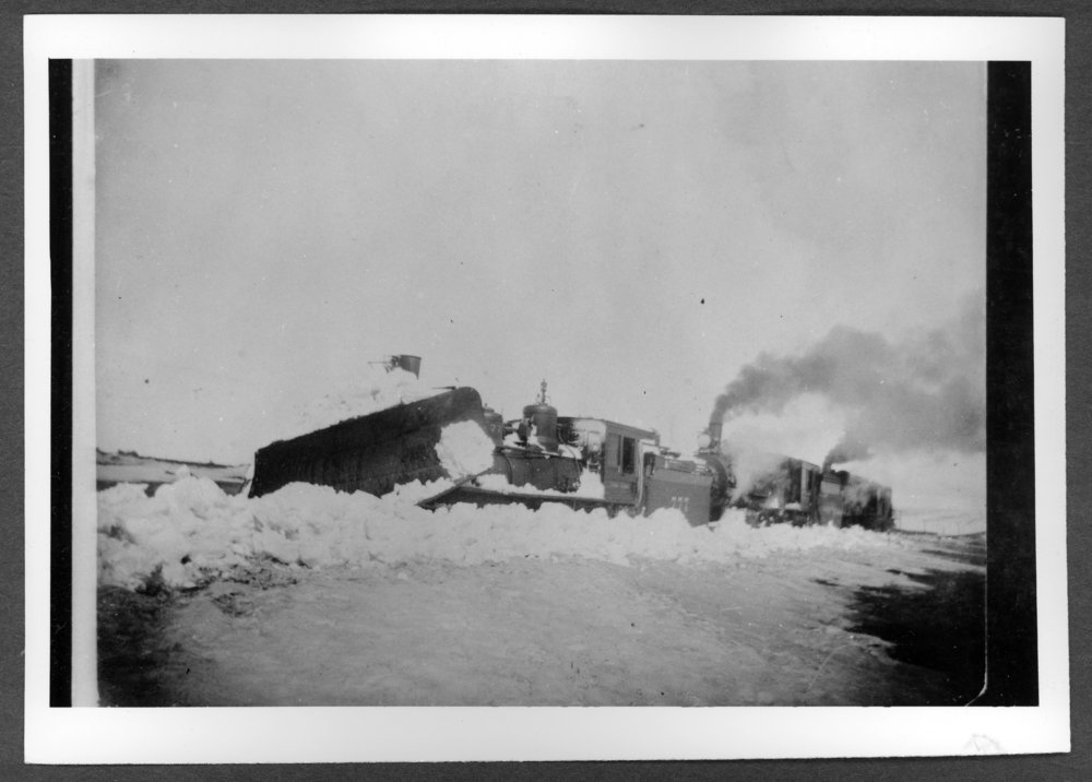 Scenes of Sherman County, Kansas - Early wedge plow and engine.