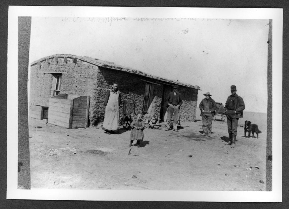 Scenes of Sherman County, Kansas - John D. Thompson homestead.  Left to right: Mrs. Thompson, Bessie Thompson, unknown, unknown, and John Thompson.