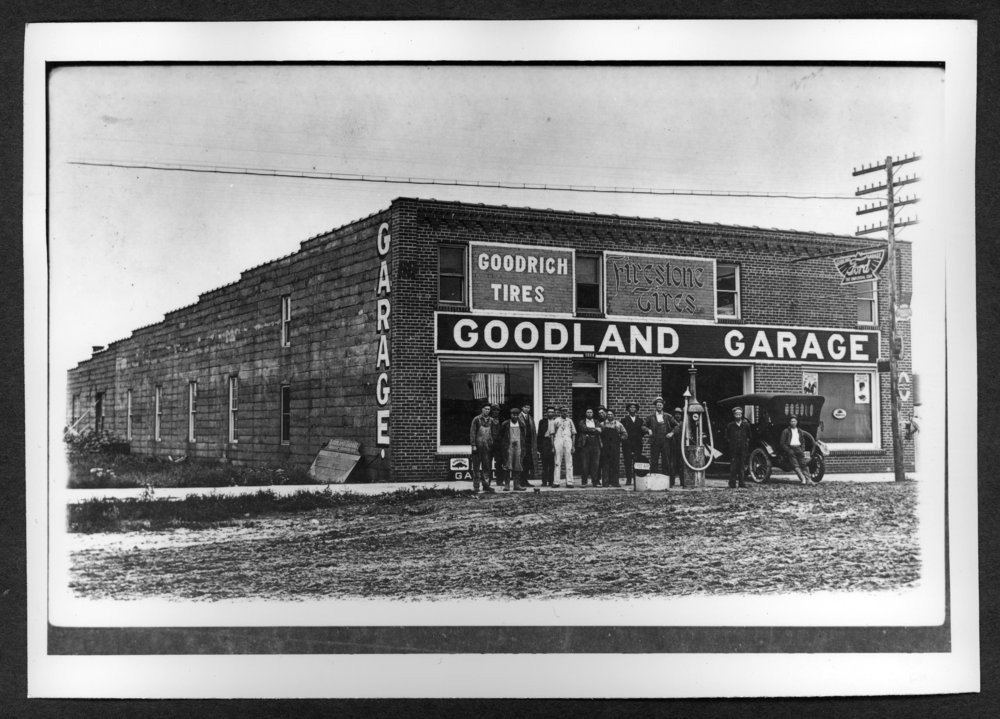 Scenes of Sherman County, Kansas - Ford garage, west side of Main between 12th and 13th.  Frank Thompson, owner, second from left.