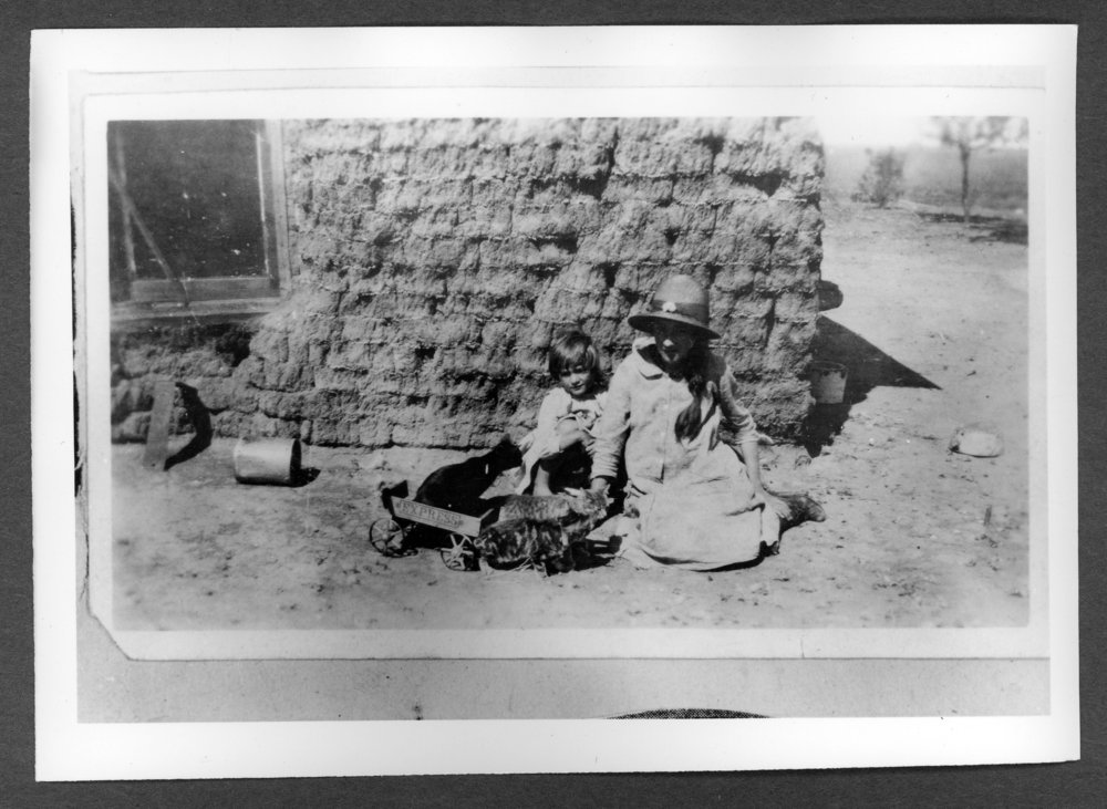 Scenes of Sherman County, Kansas - Bardwell sod house with children playing with kittens. Left to right:  Faye Bardwell Blue and Nina Bardwell.
