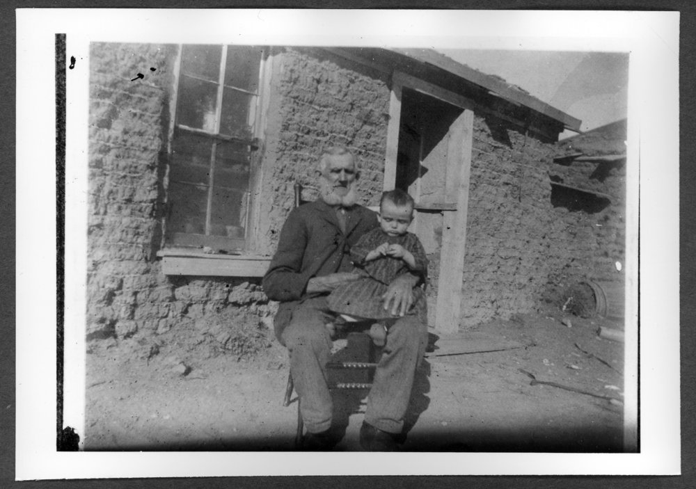 Scenes of Sherman County, Kansas - Ira Amos sod house.  Lester Ingram and his grandfather William Bundy.