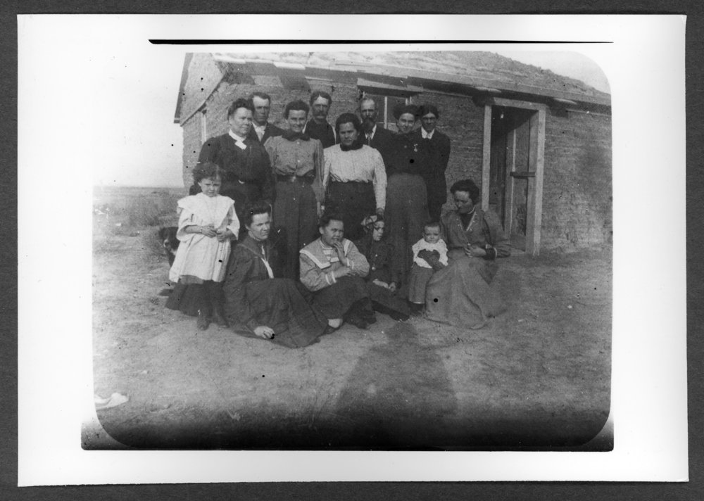 Scenes of Sherman County, Kansas - Ira Amos sod house.  Pictured are the Thompsons, Hills, and McCalls.