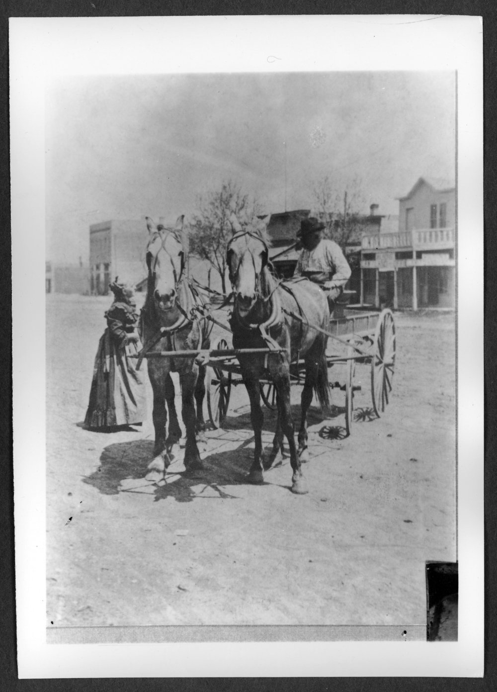 Scenes of Sherman County, Kansas - Mrs. Aver on H.H. Aver in front of a store.