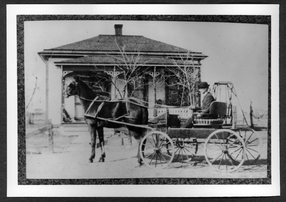 Scenes of Sherman County, Kansas - George Kelly, an early Goodland mayor, in front of his home at 124 West 16th.