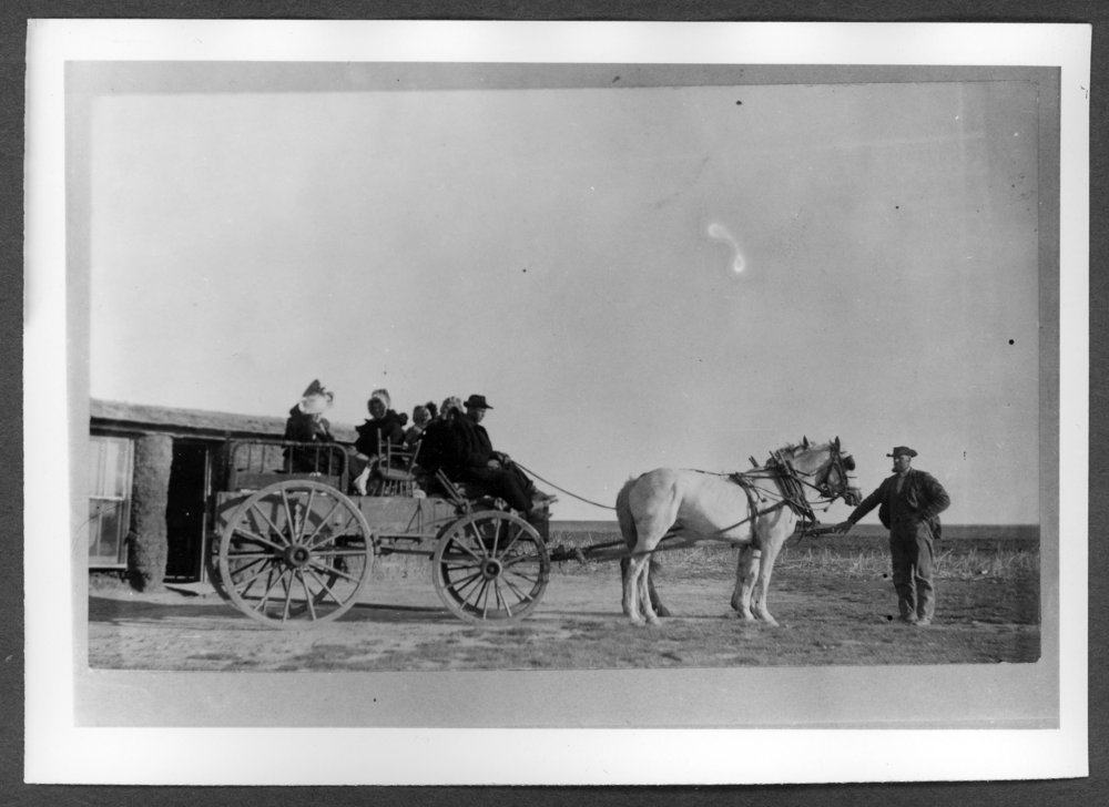 Scenes of Sherman County, Kansas - Mable and Nellie ready for school with dad driving the horses and grandad at the head of the horses.