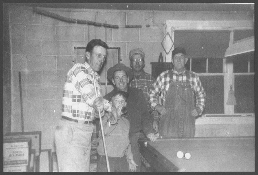 Wiley Taylor and others in his recreation parlor, Westmoreland, Kansas - 1