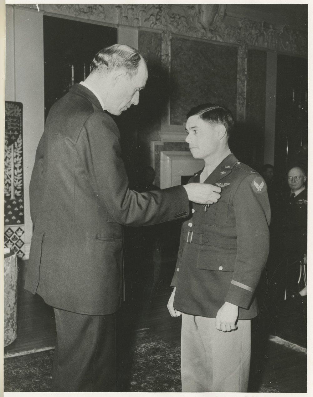 Robert S. Raymond receiving the British Distinguished Flying Cross