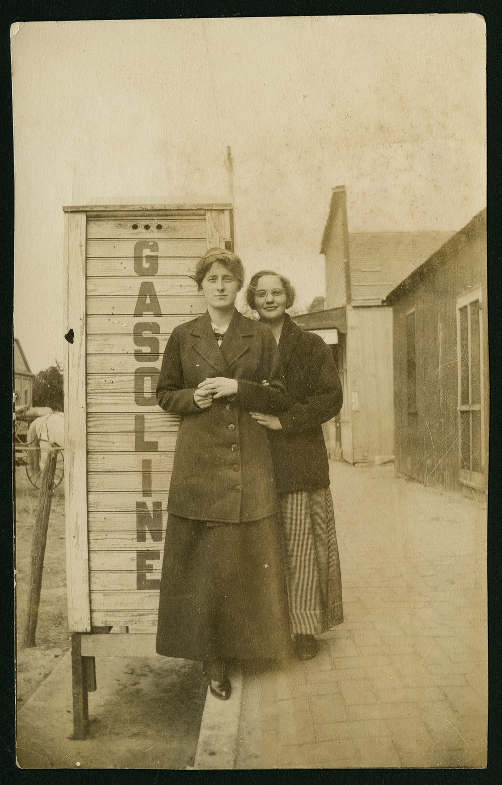 Doris Turner and Ruth Newby standing by a gasoline pump in Mount Hope, Kansas - 1