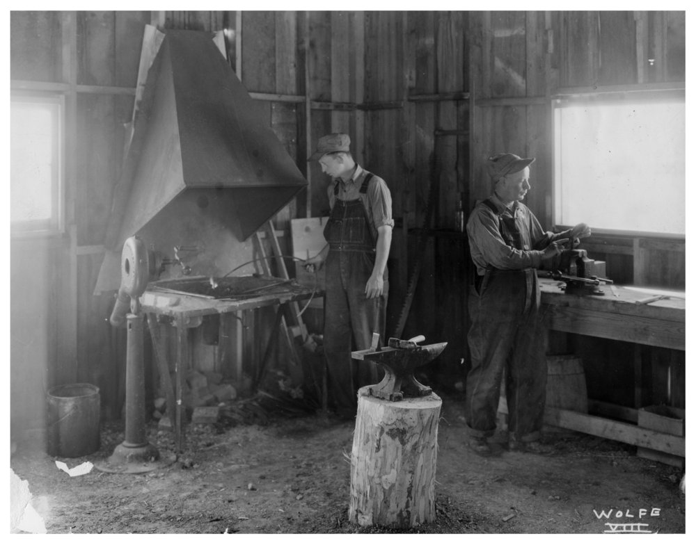 Kansas Emergency Relief Committee transient camp at Lake Wabaunsee - Two men are seen working inside the blacksmith shop.