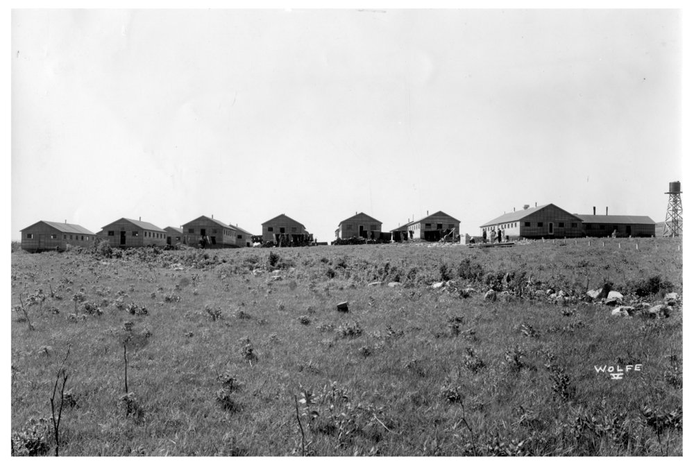 Kansas Emergency Relief Committee transient camp at Lake Wabaunsee - Stacks of firewood and clotheslines behind the living quarters.