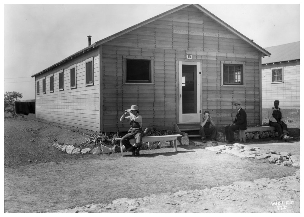 Kansas Emergency Relief Committee transient camp at Lake Wabaunsee - Four men are seated outside Barracks No. 8.
