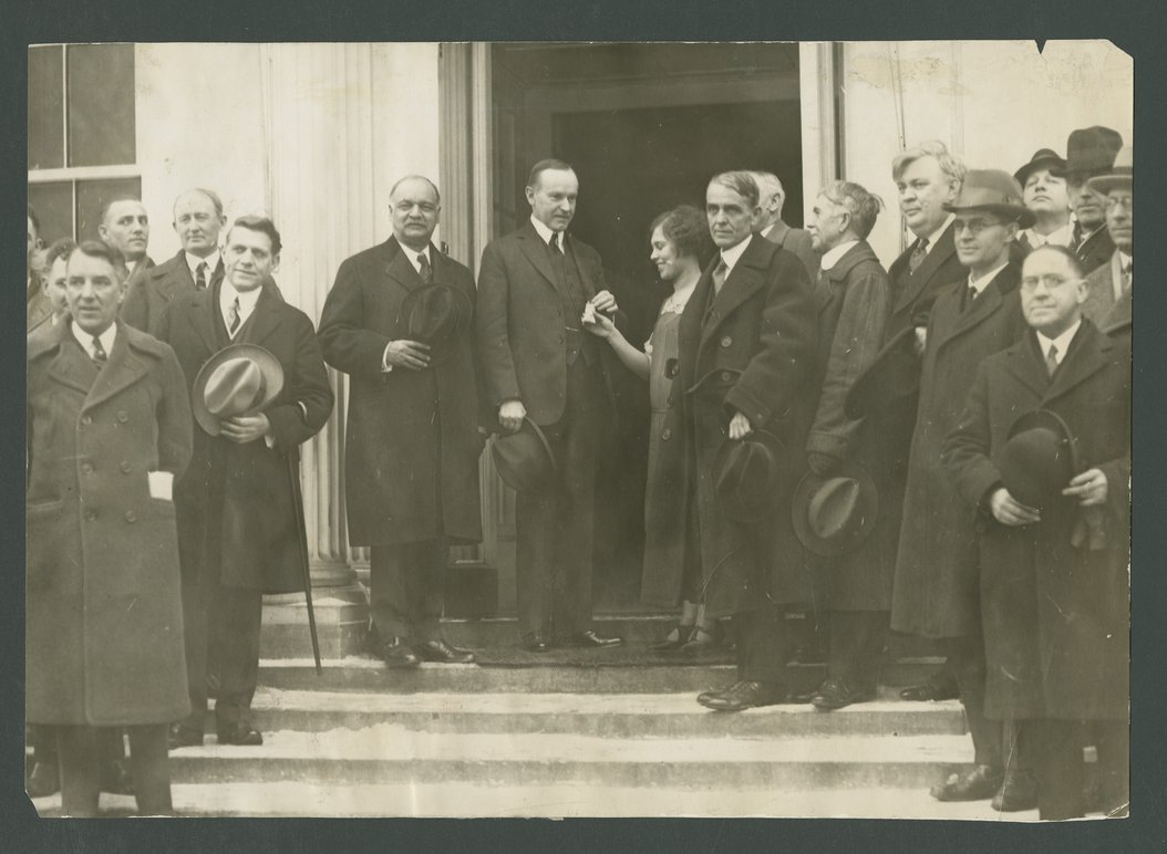 Vada Watson presenting President Calvin Coolidge with a bag of wheat - 1