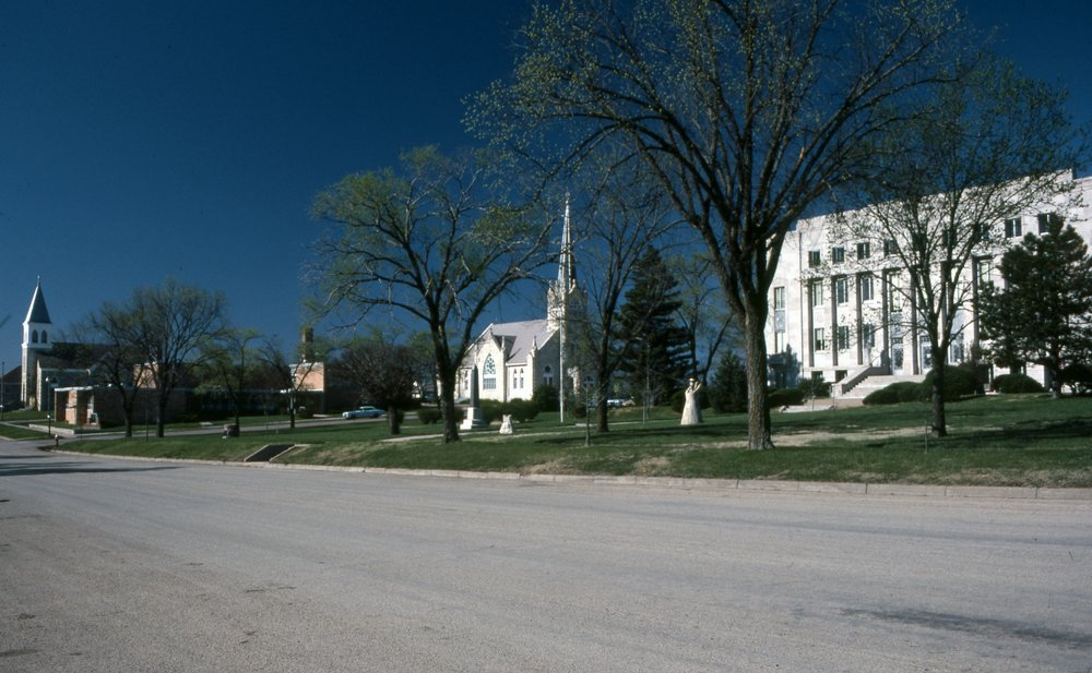 Charles Herman photograph collection - View (from the left) of the Catholic Church, Lutheran Church, and the Wabaunsee County Courthouse in Alma, Kansas.