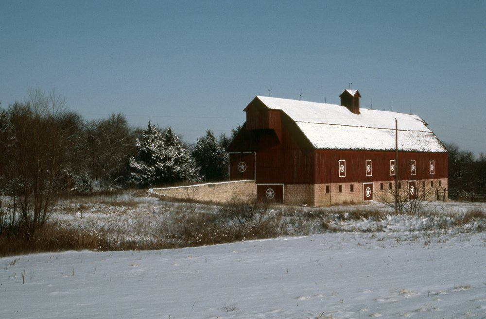 Charles Herman photograph collection - Winter view of the Sump Barn, located two miles south of Alma, Kansas.