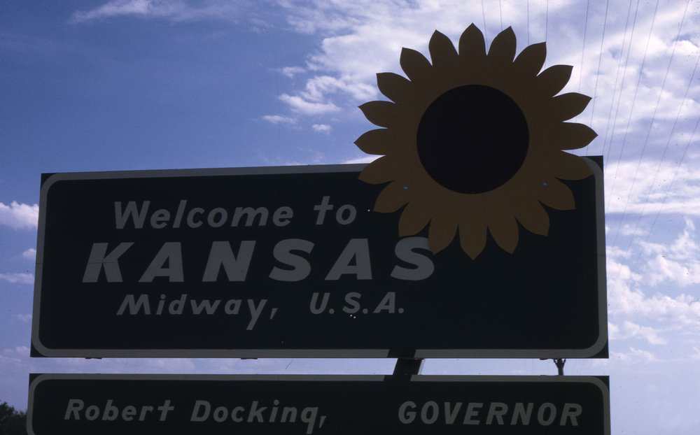 Charles Herman photograph collection - Photograph of a Welcome to Kansas sign.
