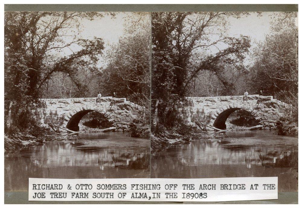 Gus Meier photograph collection - Richard & Otto Sommers fishing off bridge at the Joe Treu farm.