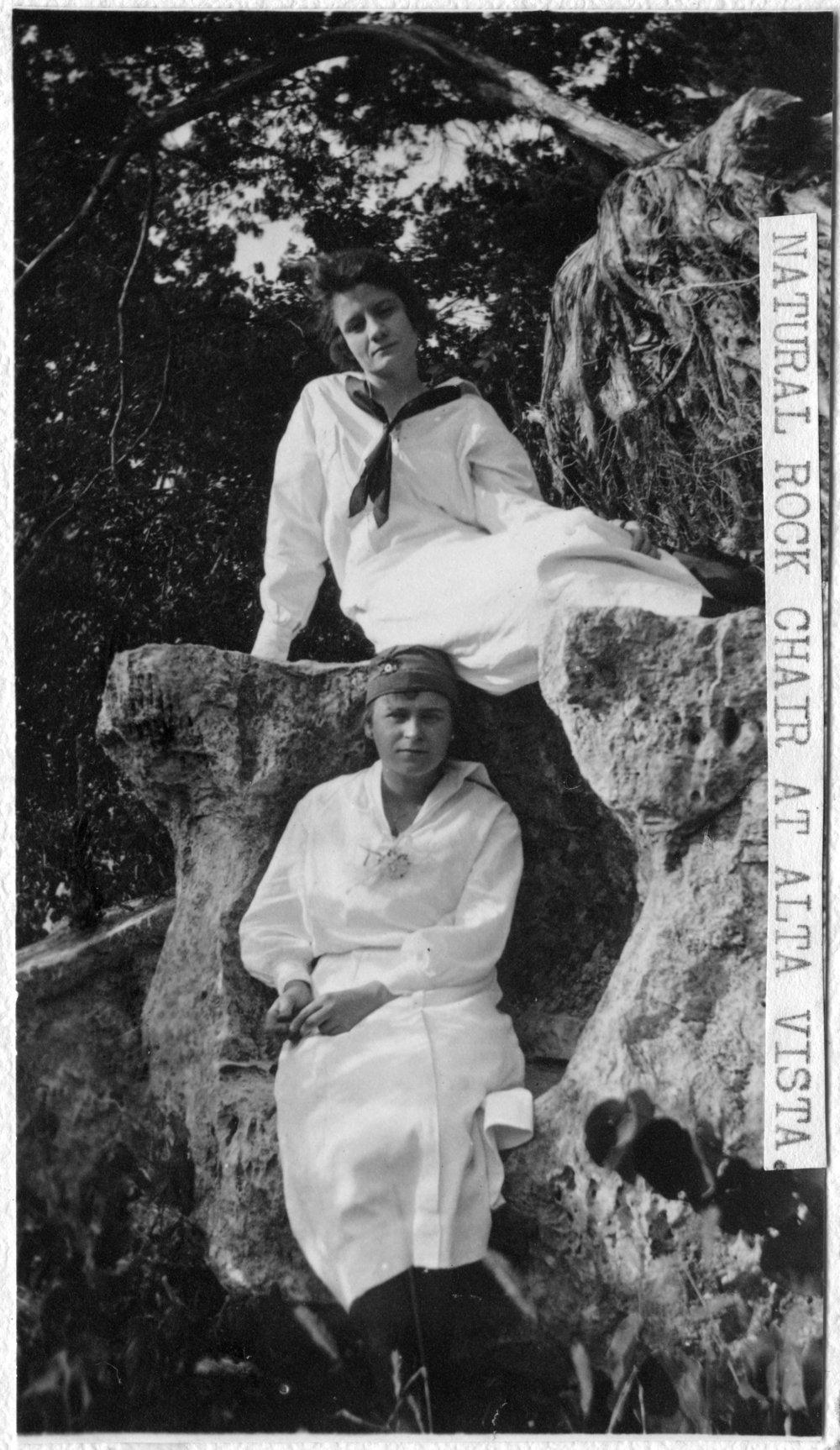 Unidentified women on natural rock chair, Alta Vista, Kansas