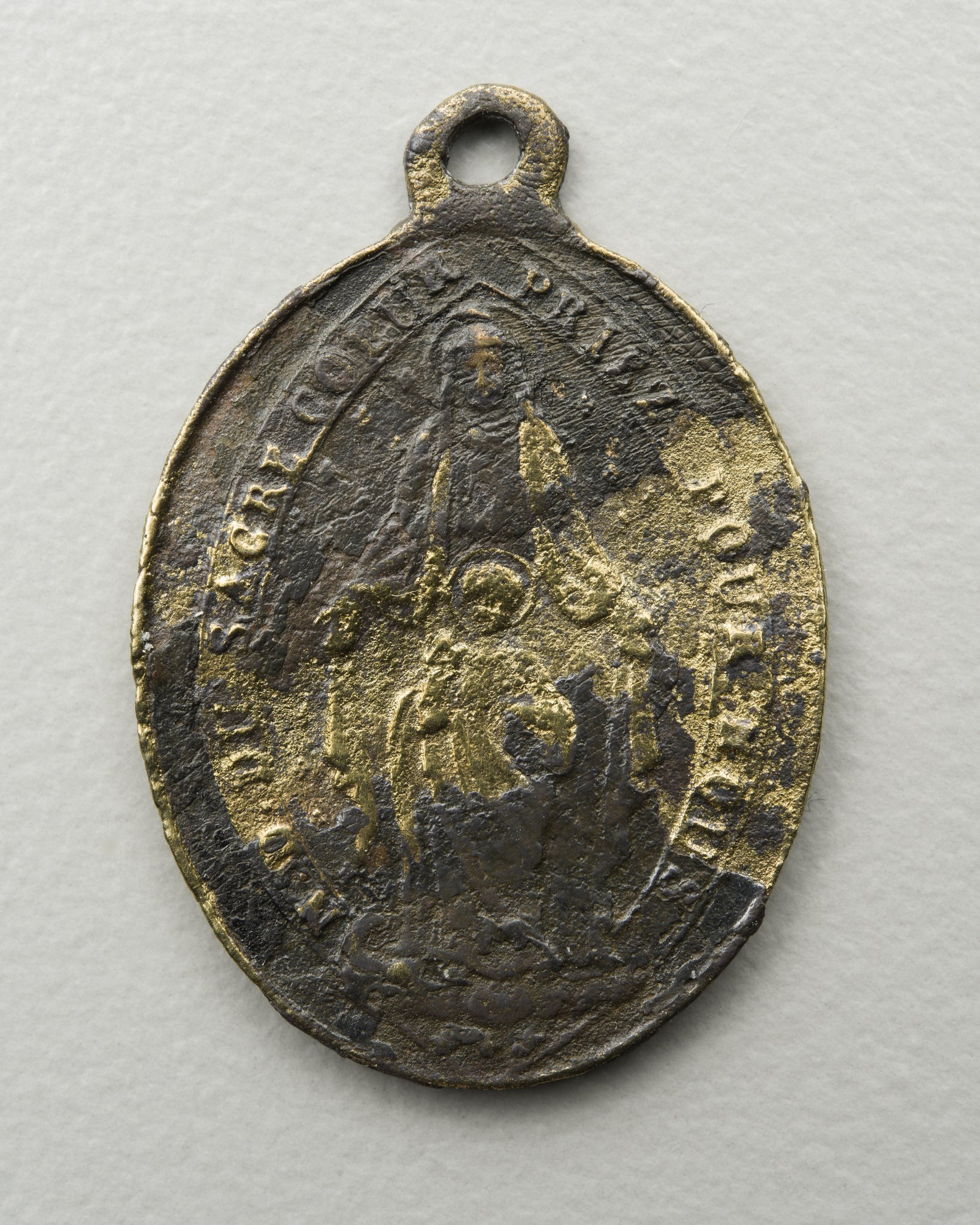 French Catholic medal found at the Canville Trading Post in Neosho County, Kansas near the Osage Reservation. Side one reads ?N. D. du Sacre Coeur Priez Pour Nous? (Our Lady of the Sacred Heart pray for us).