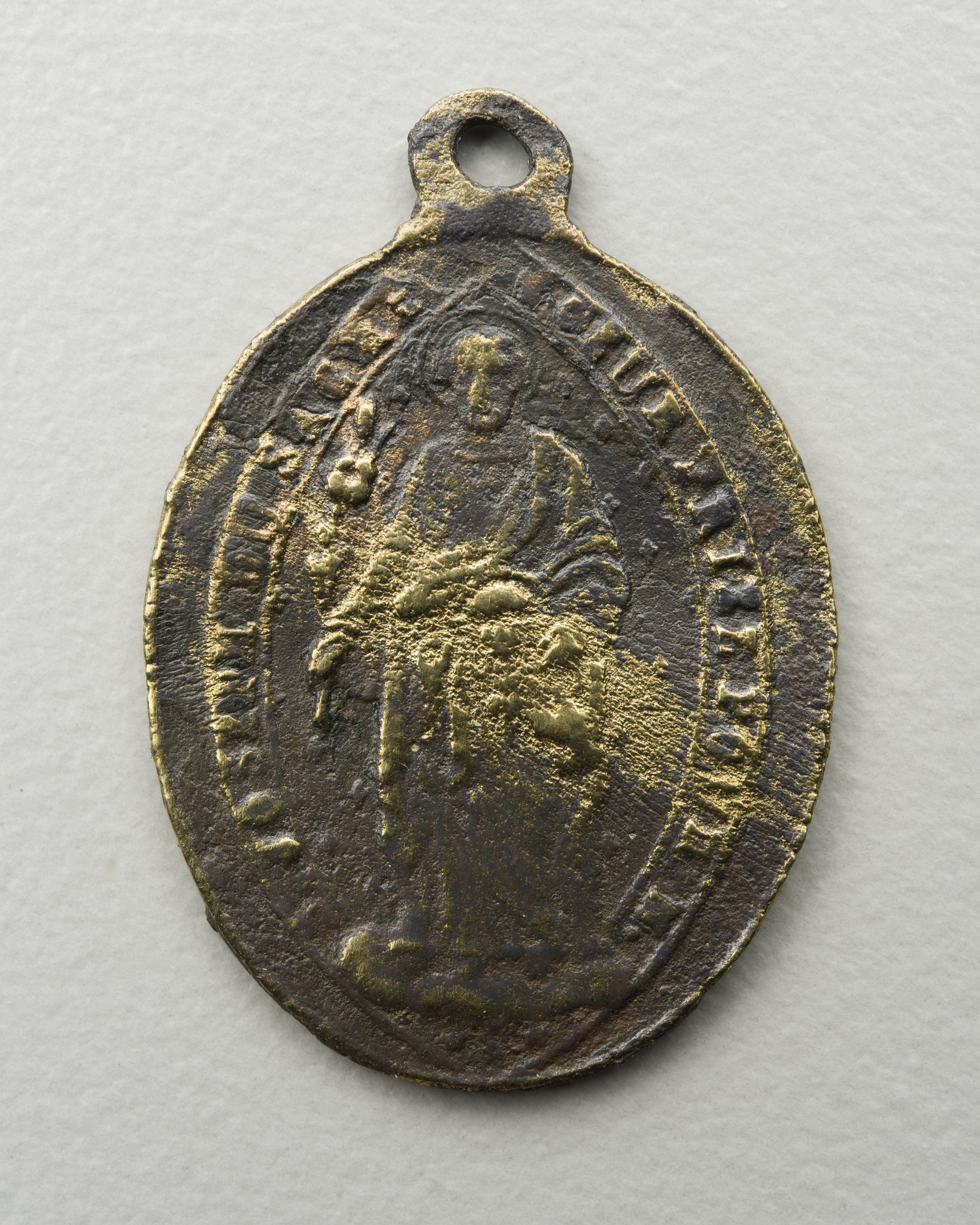 Side two reads Joseph du Sacre Couer Priez Pour N.? (Joseph of the Sacred Heart pray for us). The medal is dated between 1847 and 1872. It was donated to the Kansas Historical Society in 1994.