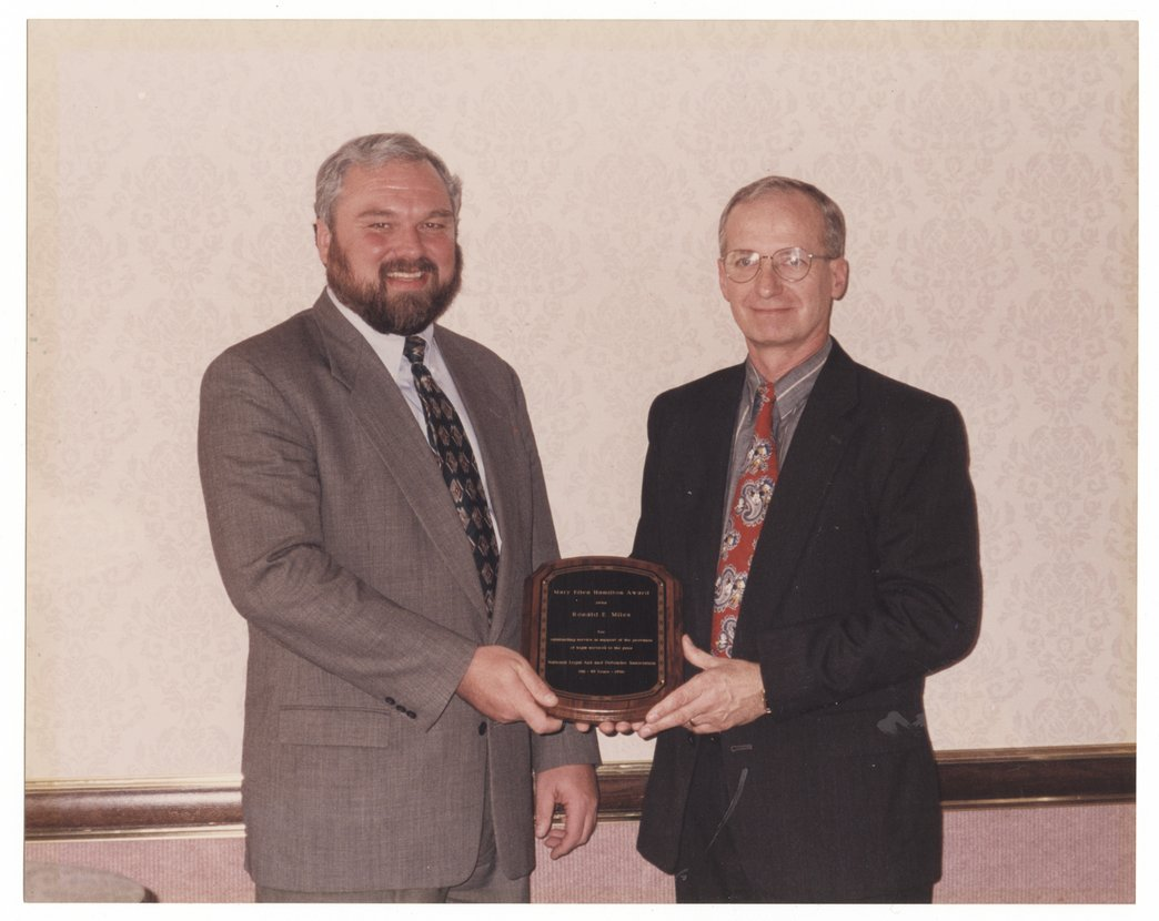 Ronald E. Miles receiving the 1996 Mary Ellen Hamilton Award