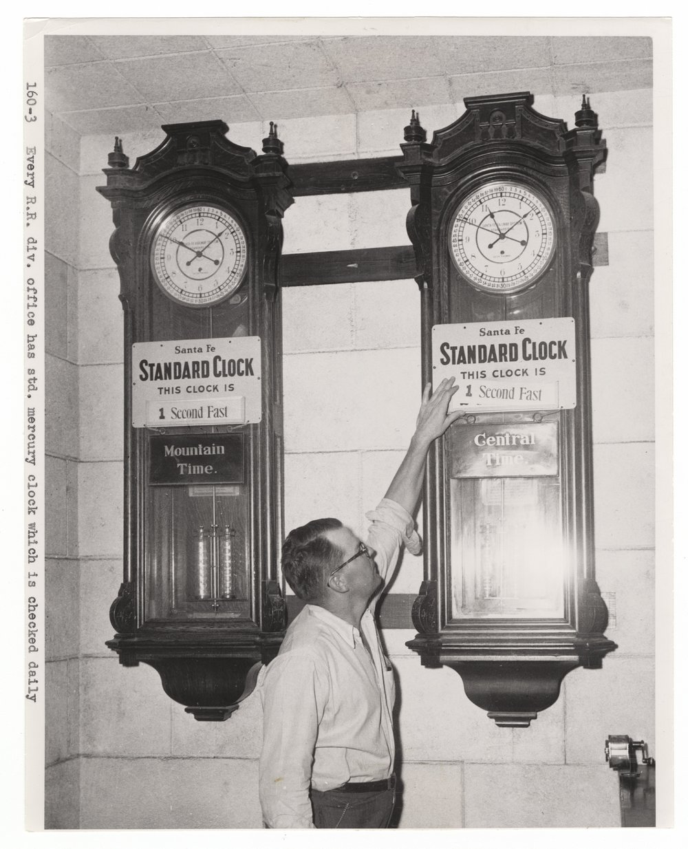 Standard mercury clocks in Atchison, Topeka & Santa Fe Railway's division offices - 1