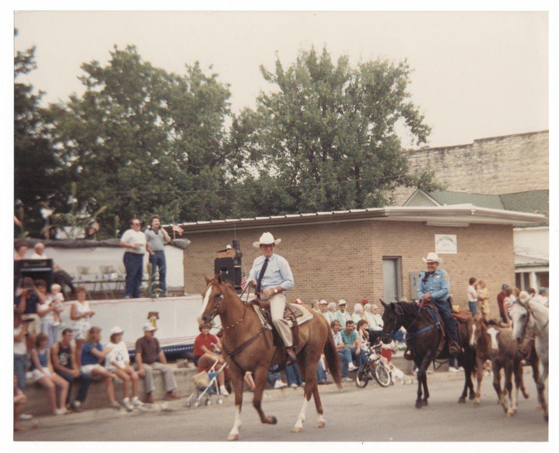 Governor John Carlin riding in a parade