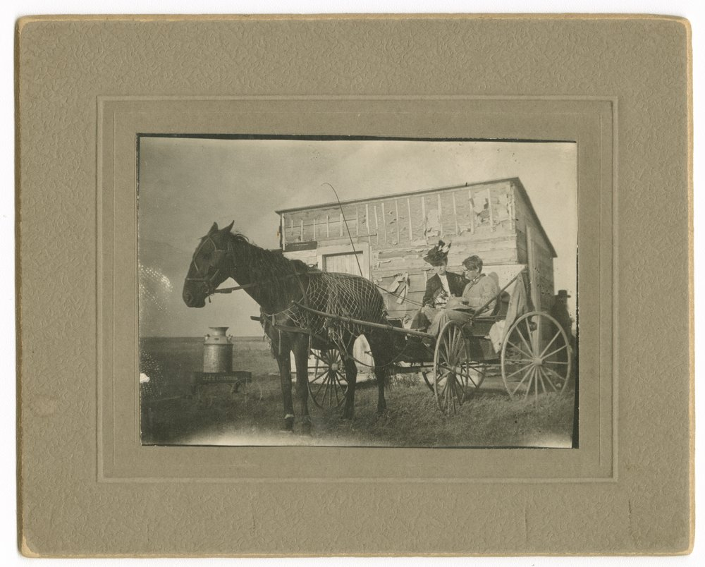 Allena (Mrs. D.E.) Snell and R.G. Snell in buggy on the Snell homestead, Thomas County, Kansas - 1