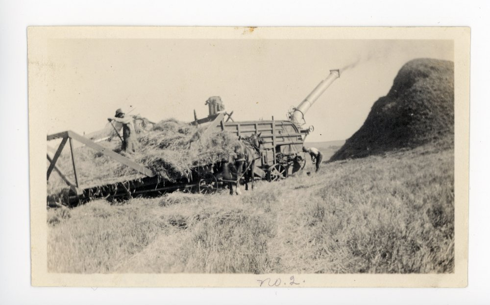 Combine harvesting wheat, Butler County, Kansas - front