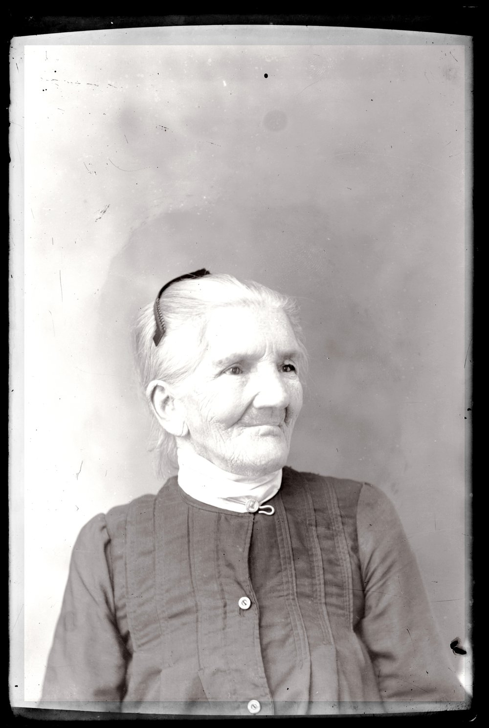 Michael A. Kennedy photo collection, St. Paul, Kansas - Portrait of women in black dress with white detachable collar and hair comb (2762)