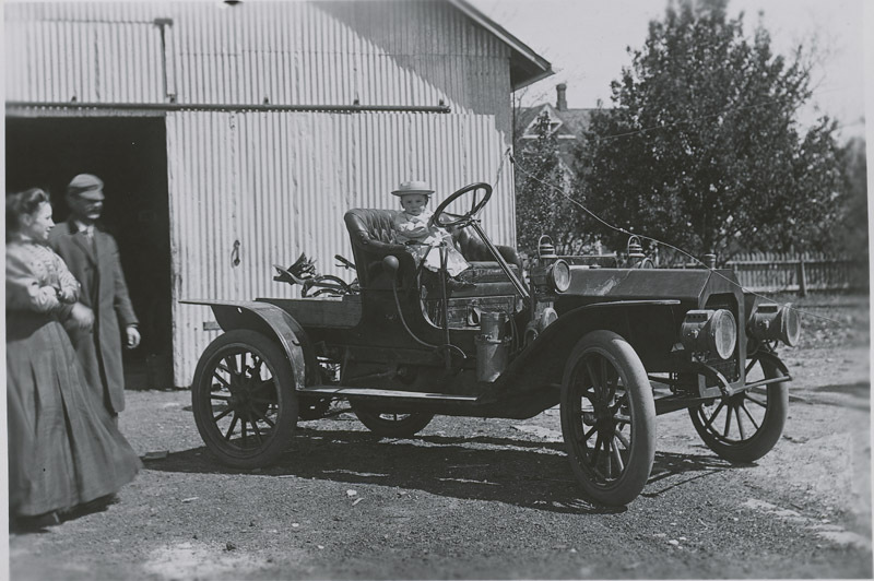 Elmo Mahoney in a Reo automobile, Dorrance, Kansas