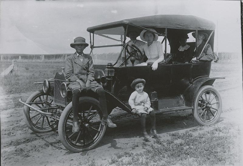 Charlotte Hopper driving a Ford automobile, Dorrance, Kansas
