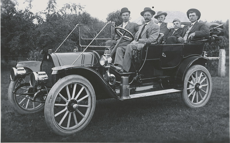 G. P. Thielen and his automobile, Dorrance, Russell County, Kansas