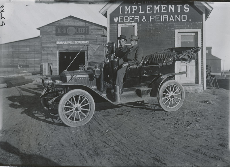 F. W. Jordan and Leo Sterns in an automobile, Dorrance, Kansas