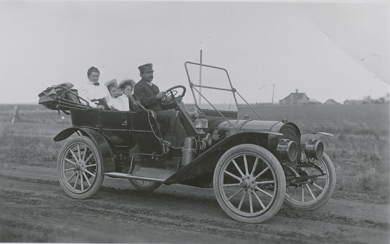 Fred Major and family in automobile, Russell County, Kansas