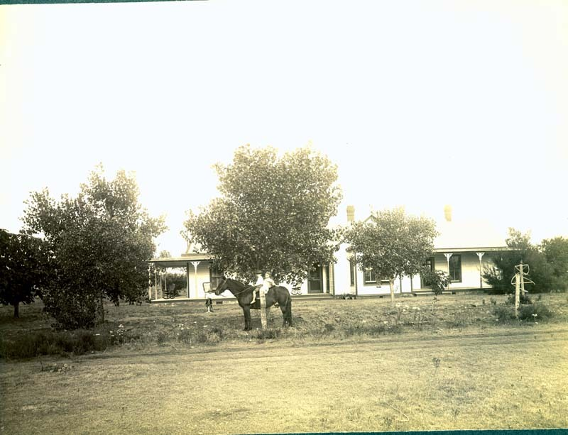 Children in the yard of a residence, Clark County, Kansas