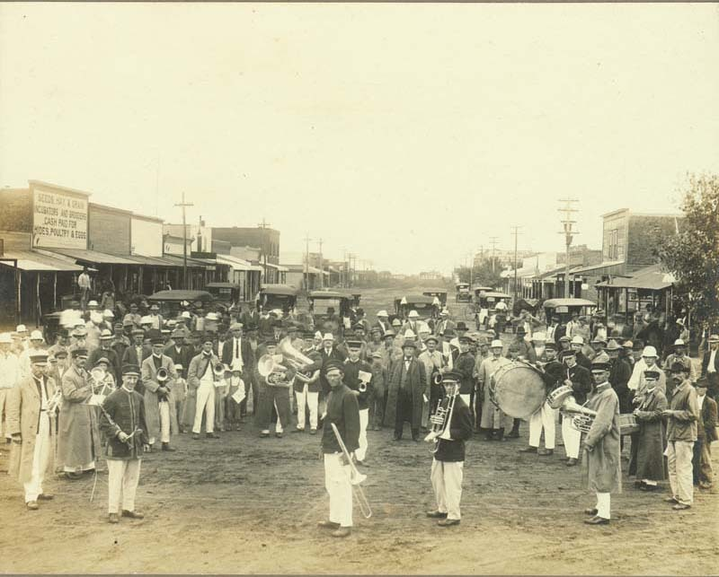 Liberal Boosters, a band, and a crowd in Hooker, Oklahoma