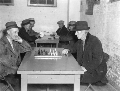 Men playing chess and cards